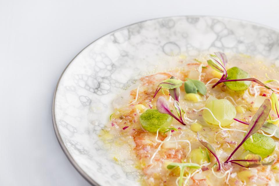 A dish of red shrimp ceviche with cucumber and yellow ají peppers at SHA Wellness Clinic.