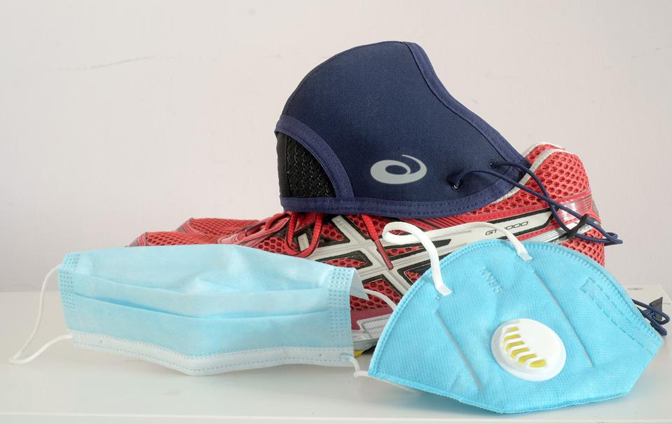A photo of the three masks on test, plus a pair of running shoes.