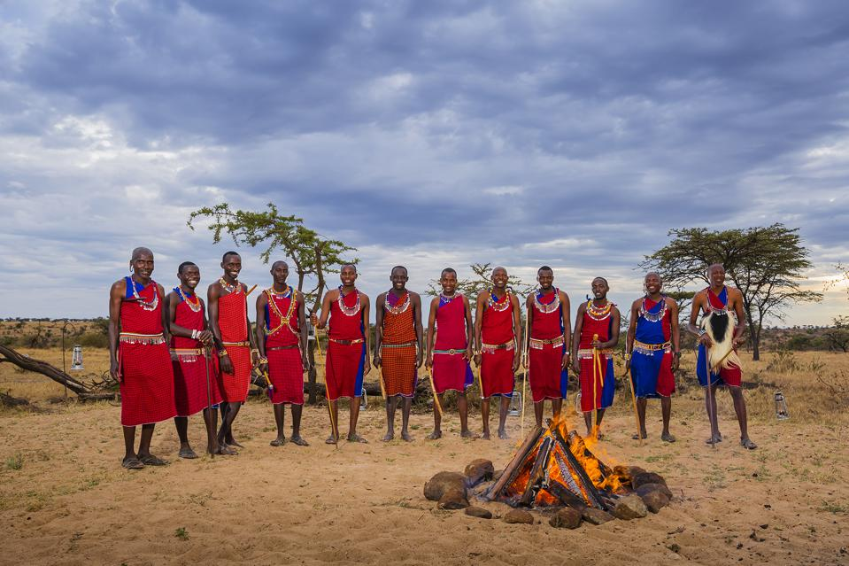 Maasai tribe members in bright red traditional dress
