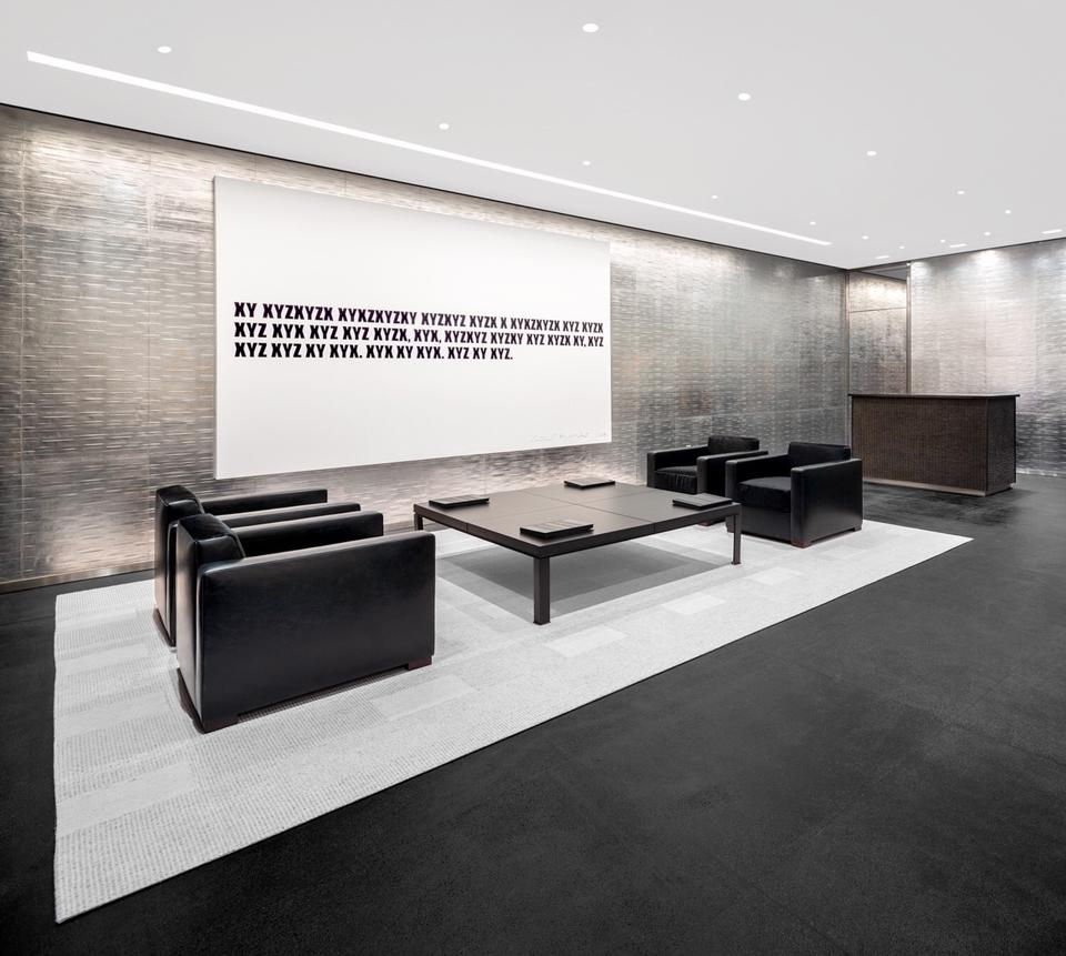A building lobby in black and gray.