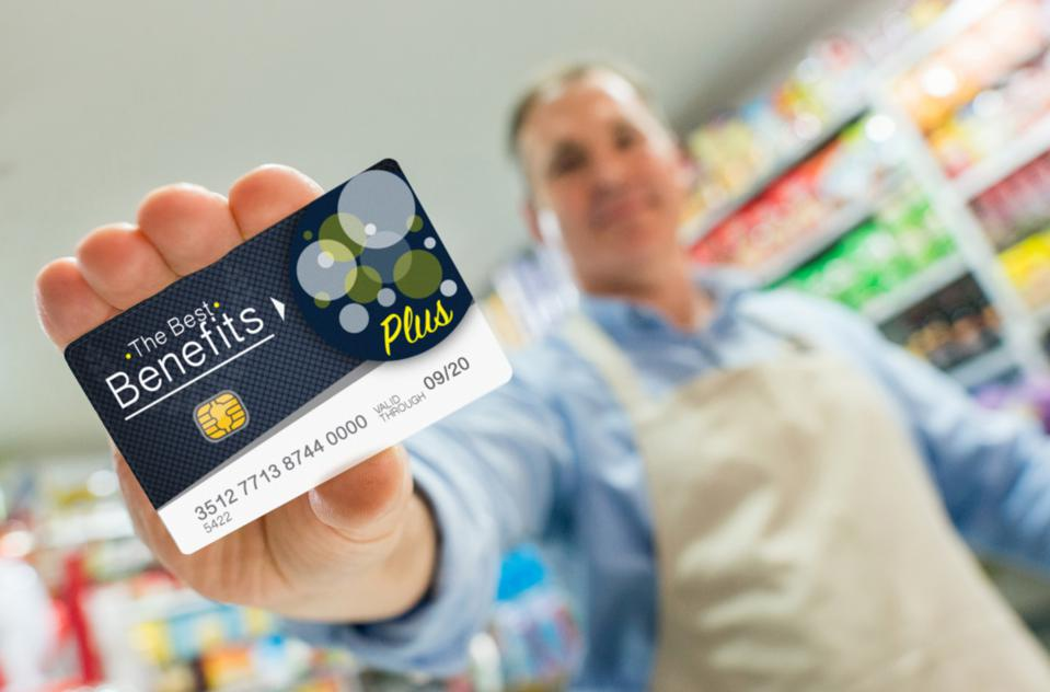 Man at a store holding a loyalty card
