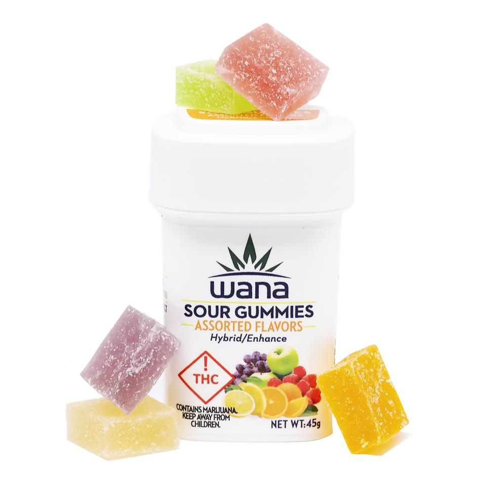 White container of wana brand sour gummies with multicolored rectangular gummies on top and on the sides