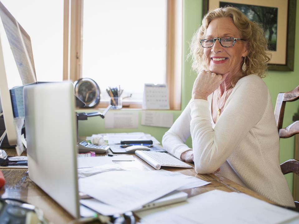 Mature woman working in home office
