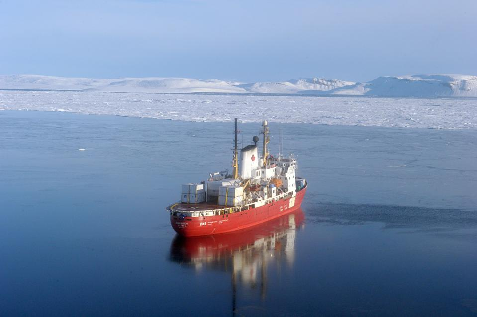 An aerial view of the CCGS Amundsen, a Canadian reasearch ice-breaker navigating near an ice floe along Devon Island, in the canadian High Arctic. CLEMENT SABOURIN/AFP via Getty Images