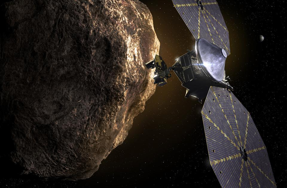 This artist's concept shows the Lucy spacecraft observing a Trojan asteroid. This NASA mission, led by Southwest Research Institute, passed a major milestone in preparation for the spacecraft launch in 2021.