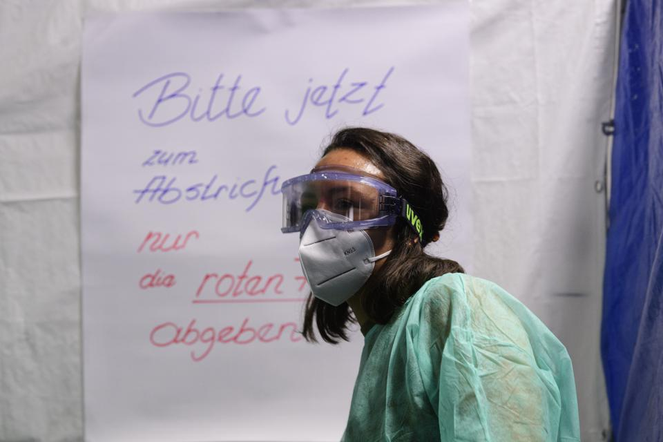 health worker in mask at Coronavirus test centre at Dresden Airport Germany Europe