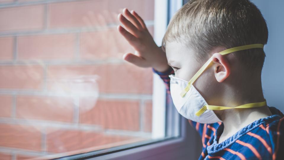 Coronavirus epidemic. Boy with protection mask. Kid in school. Learning, homework, homeschooling, quarantine at home