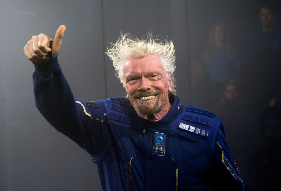 Virgin Galactic Founder Sir Richard Branson demonstrates a spacewear system, designed for Virgin Galactic astronauts.