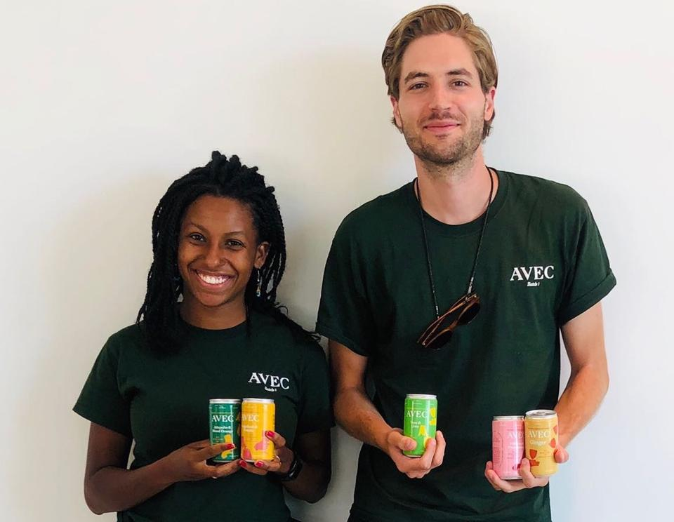 AVEC DRINKS Company Co-Founders Dee Charlemagne and Alex Doman holding 5 cans of their 5 flavors of mixers.