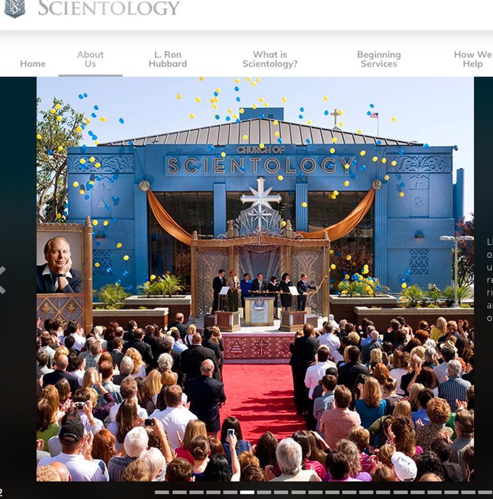 Rep. Bass (in blue) on the stage for the 2010 dedication of Scientology's LA headquarters.