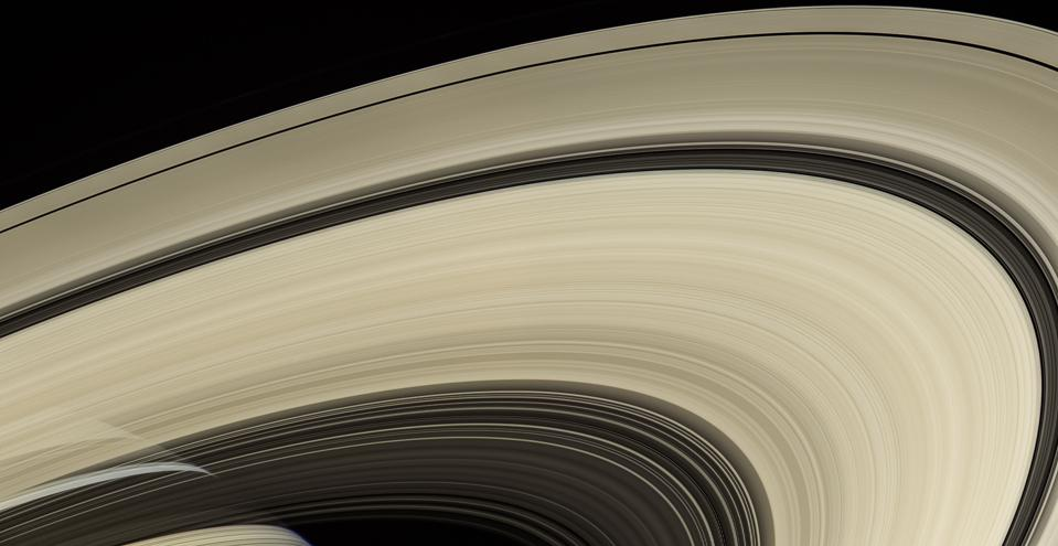 This image from Cassini shows Saturn's rings, which are made mostly of particles of water ice that range in size from smaller than a grain of sand to as large as mountains.