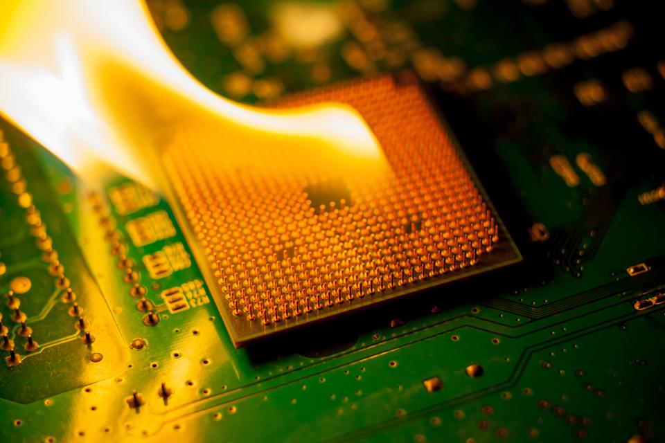 fire Burning cpu on circuit board with electronic