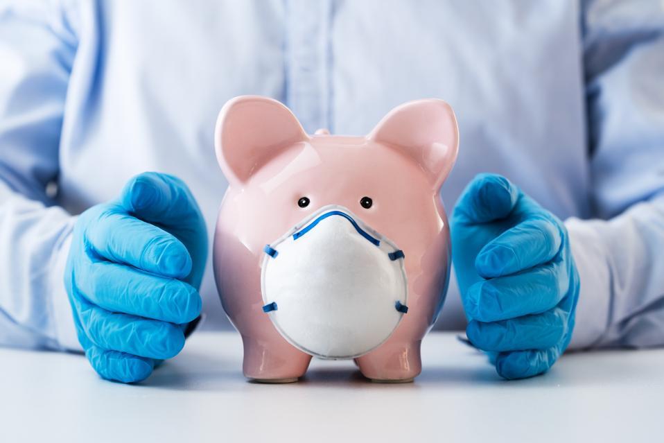 Human Hand Protecting Piggy Bank