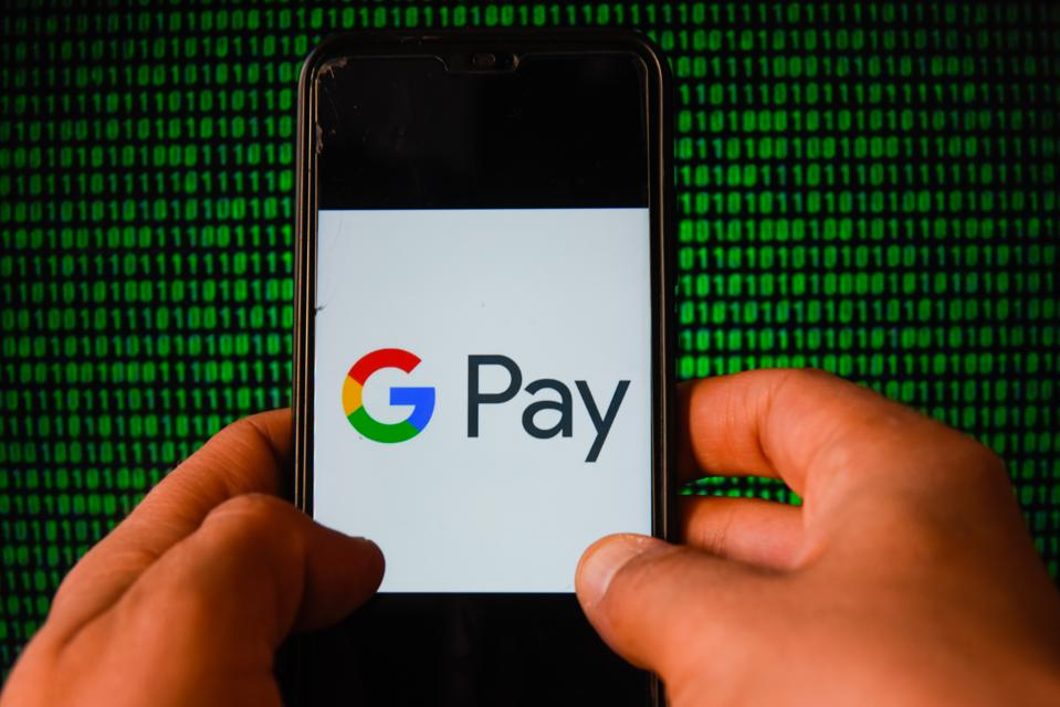 In this photo illustration a Google Pay logo is seen...