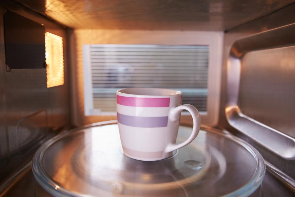Warming Cup of Water Inside Microwave Oven