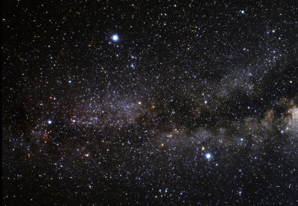 The three bright stars of the Summer Triangle: Vega, Deneb, and Altair.