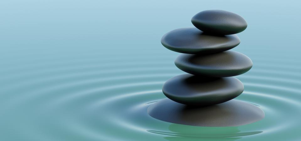 Stones balance in the turquoise water