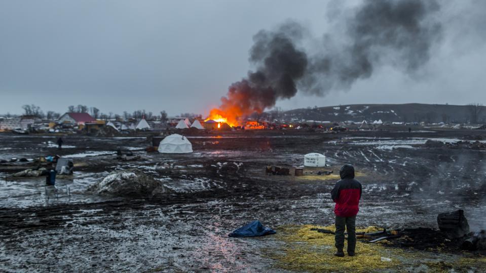 Defiant Dakota Access Pipeline water protectors faced-off...