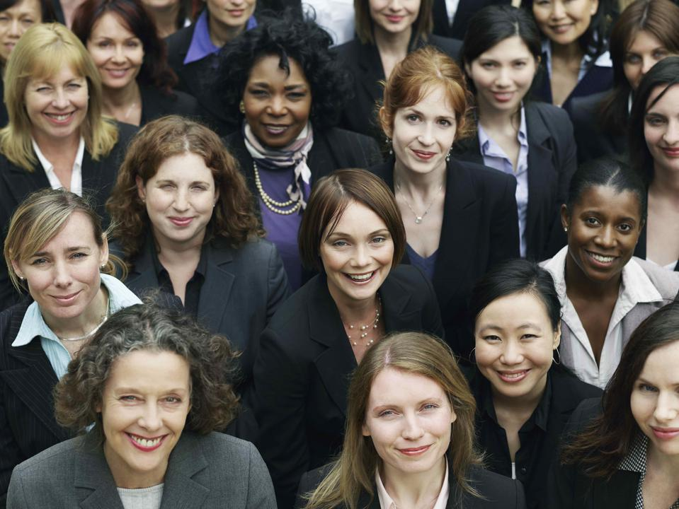 A group of professional businesswomen looking up at the camera.