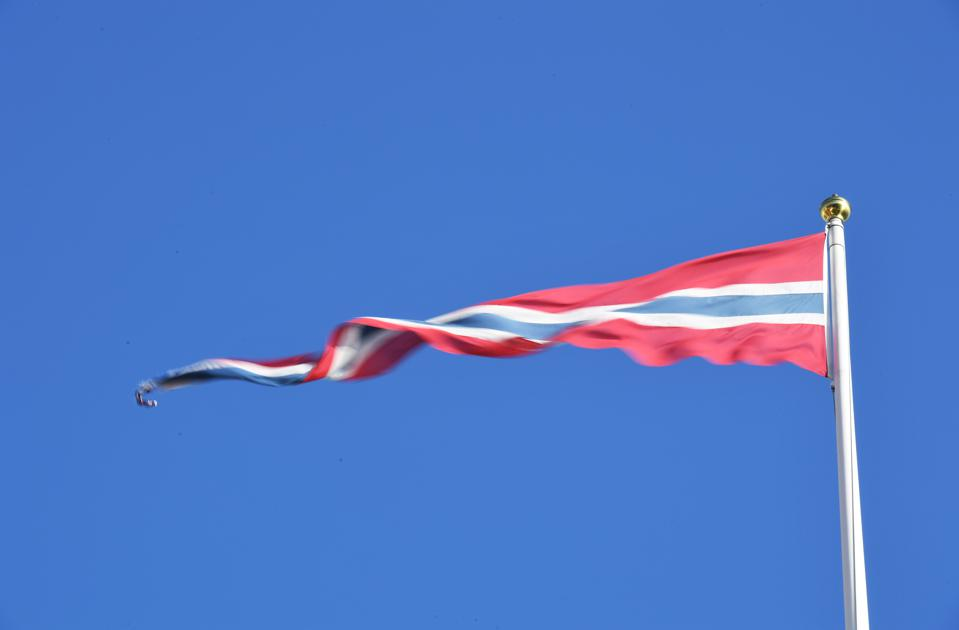The Norwegian vimple flag against a blue sky