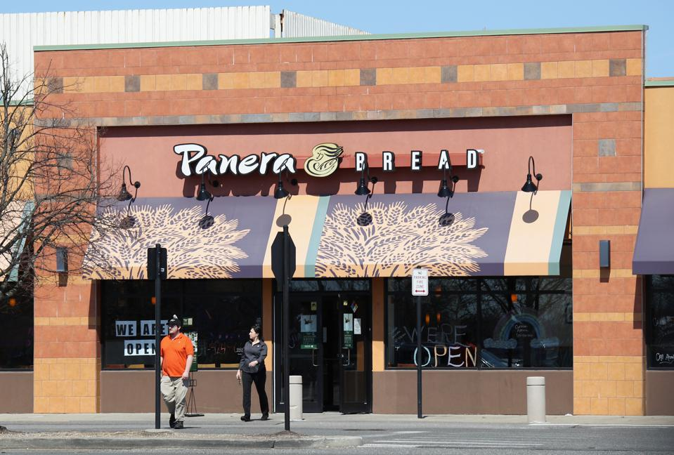 Customers visit Panera Bread on March 26, 2020 in Huntington Station, New York.