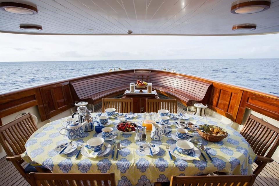 Breakfast is served at the bow of the 1920's era yacht Fair Lady.