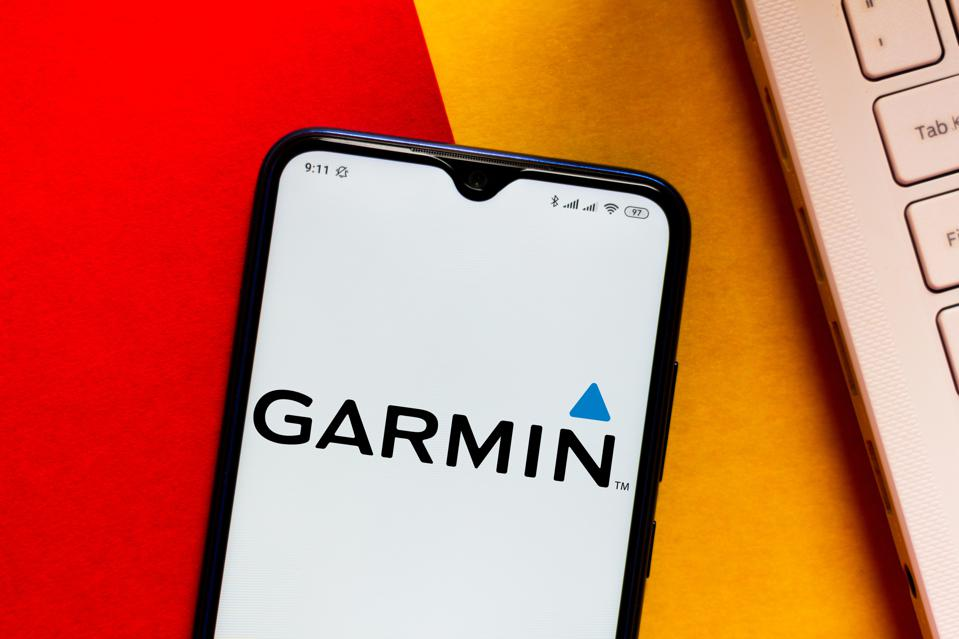 In this photo illustration the Garmin logo seen displayed on...