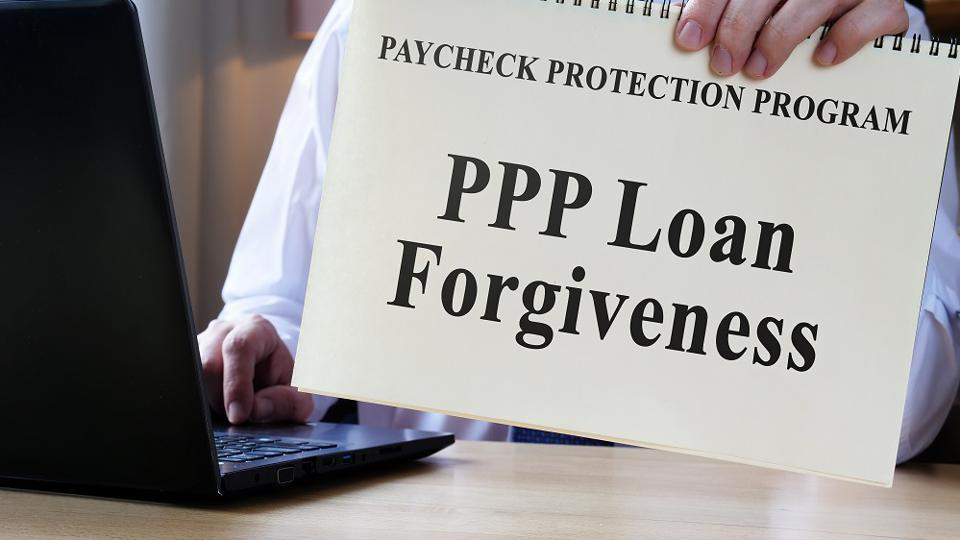 Accountant shows form for PPP loan forgiveness.