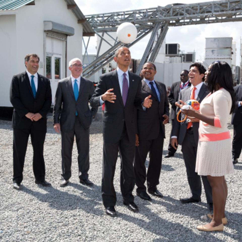 Barack Obama tosses a Soccket ball in the air at the Ubongo Power Plant in Dar es Salaam, Tanzania