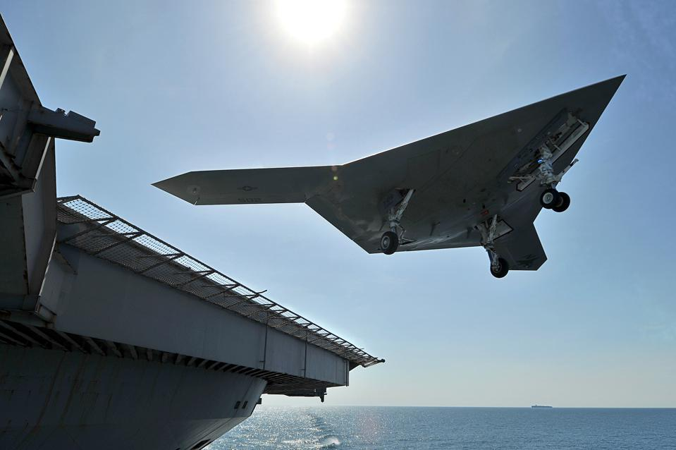 Unmanned Combat Air System Executes Touch and Go Landing On Flight Deck