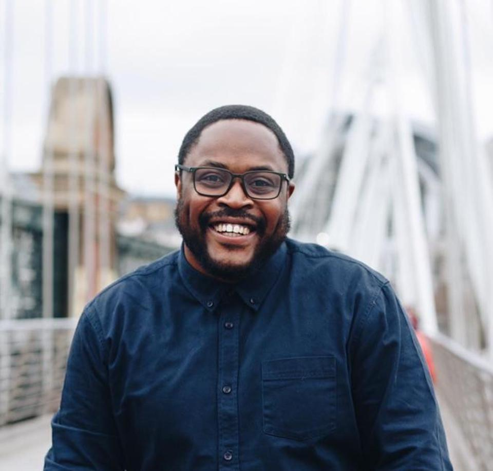 Tumi Sotire, aka ″The Black Dyspraxic″, economics and social policy researcher, smiling.