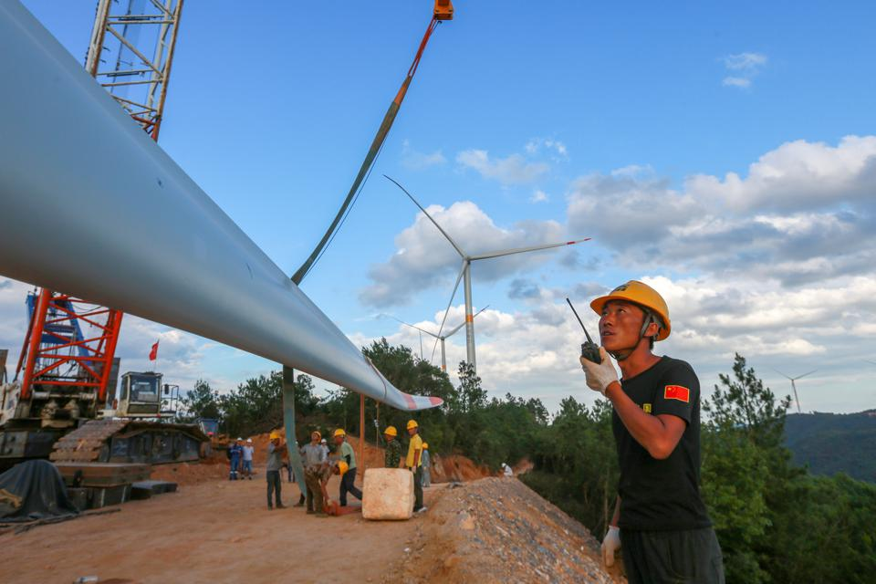 Wind Turbines Installation On Mountain In Ji'an