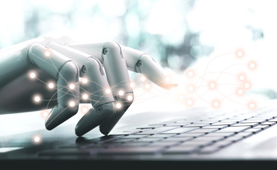Robot hand chatbot pressing computer keyboard enter