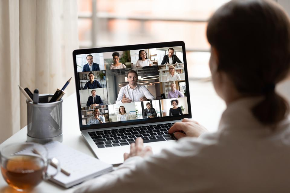 Business professional having virtual meeting with coworkers
