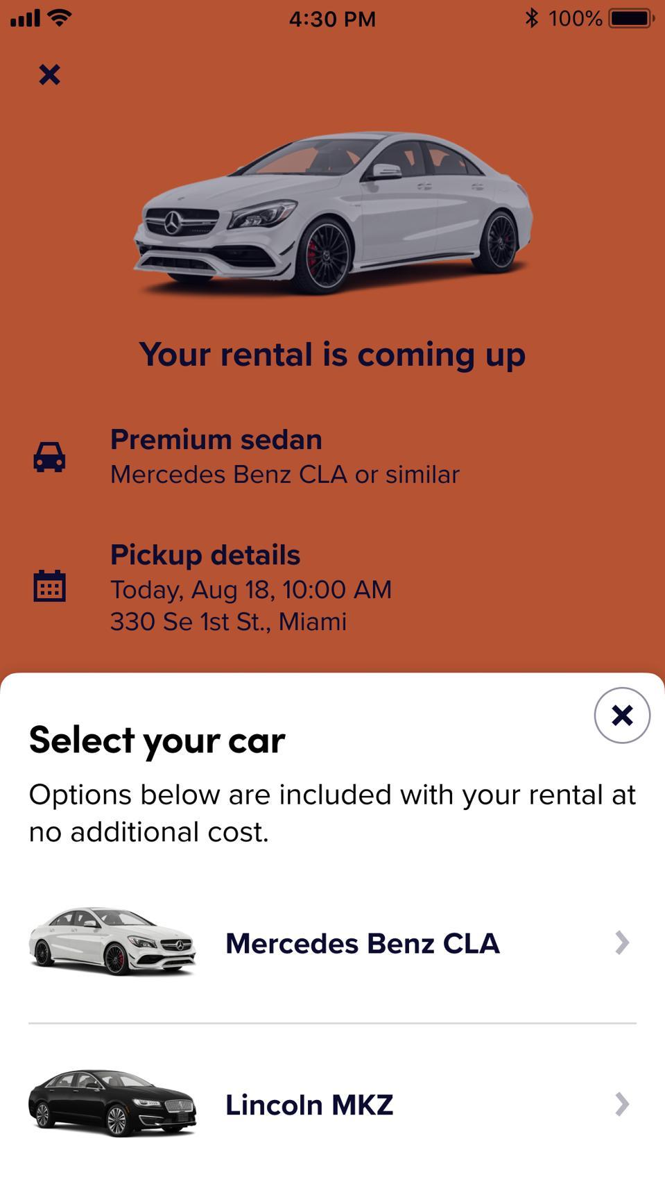 Smartphone screen showing car rental information.