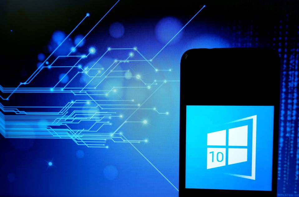 Windows 10 logo on a smartphone with an abstract image of lines behind