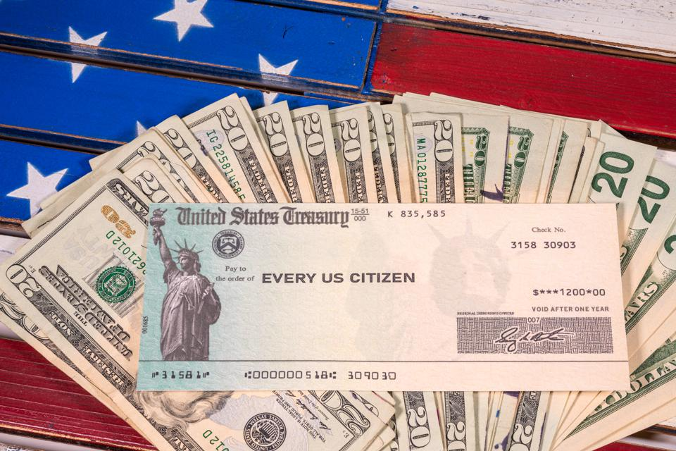 Illustration of the federal stimulus payment check with stack of cash on US Flag
