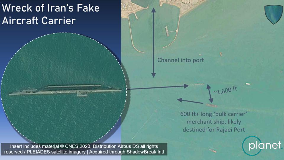 Satellite imagery showing that the wreck of Iran's fake aircraft carrier is a hazard to ships