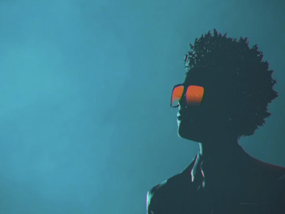 the singer's virtual avatar stares into space.
