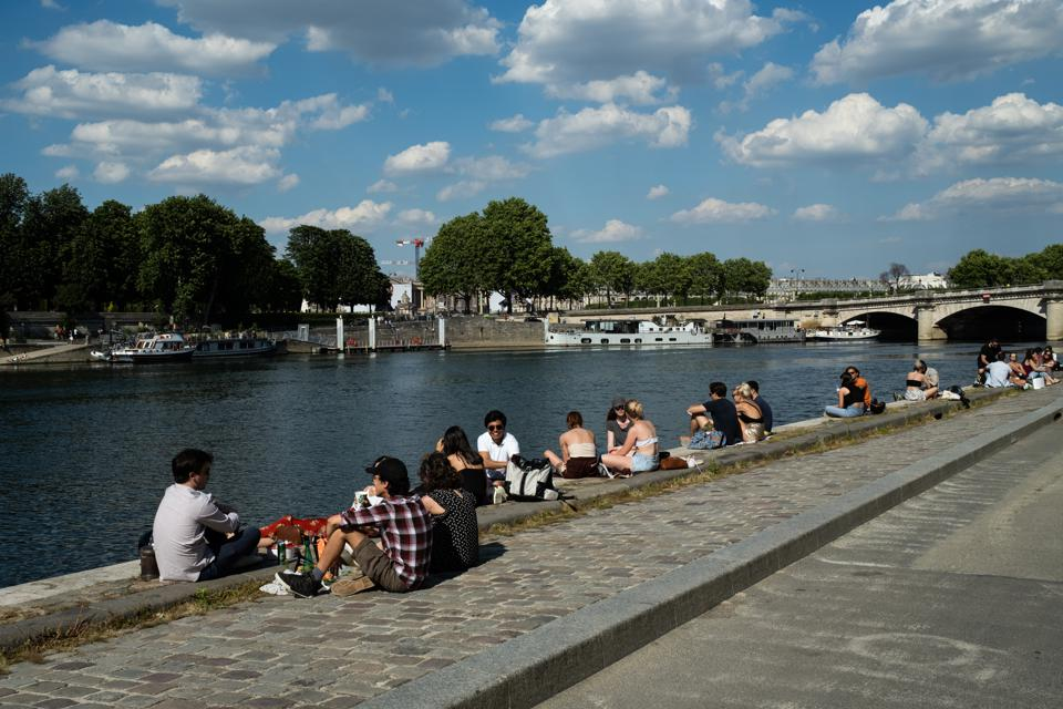 People on the Seine riverside in Paris where now masks will be mandatory outdoors