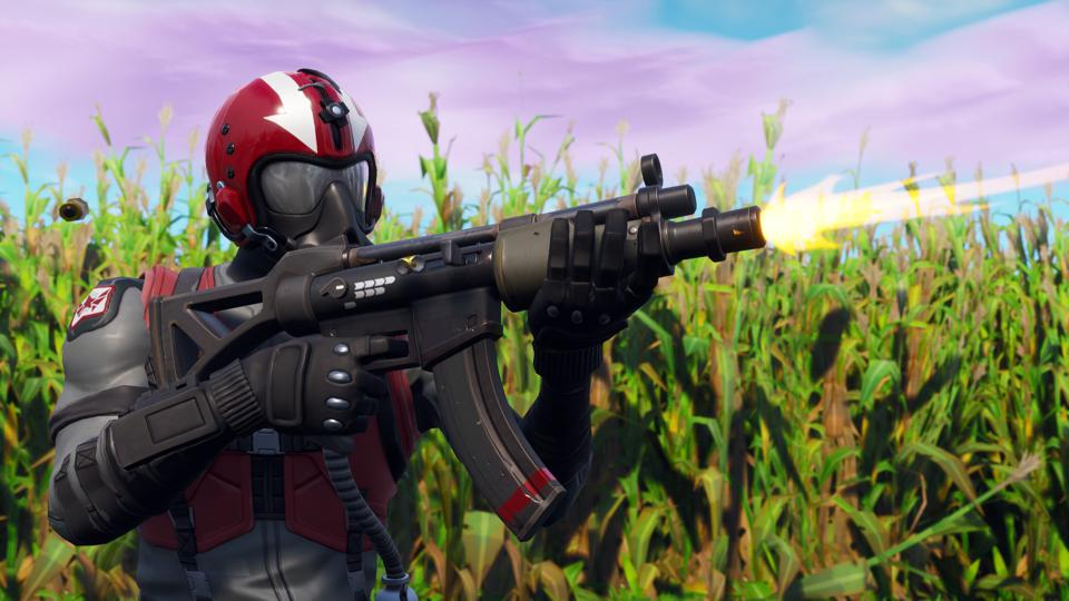 A Fortnite player fires the assault rife.
