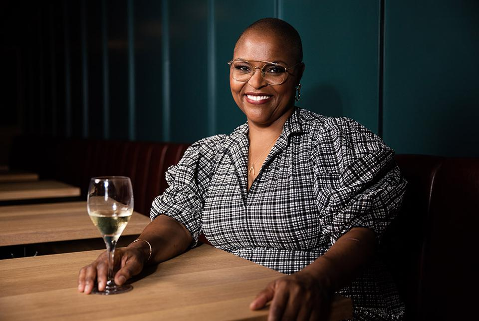 Chef Tanya Holland with a glass of white wine