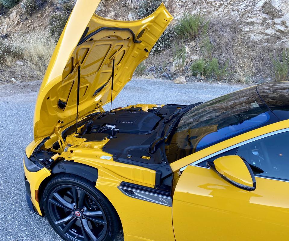 Hood tilts forward, a nod to Jaguar sports car heritage.