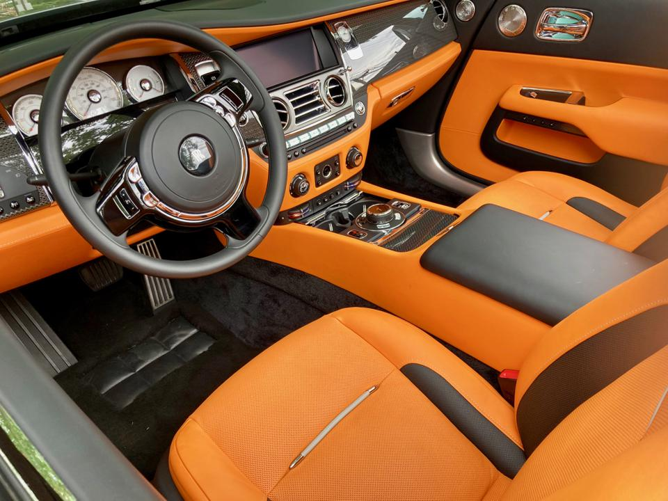 The Rolls-Royce Dawn handsome hand crafted cabin offers an elegant escape from reality. But oh that orange!