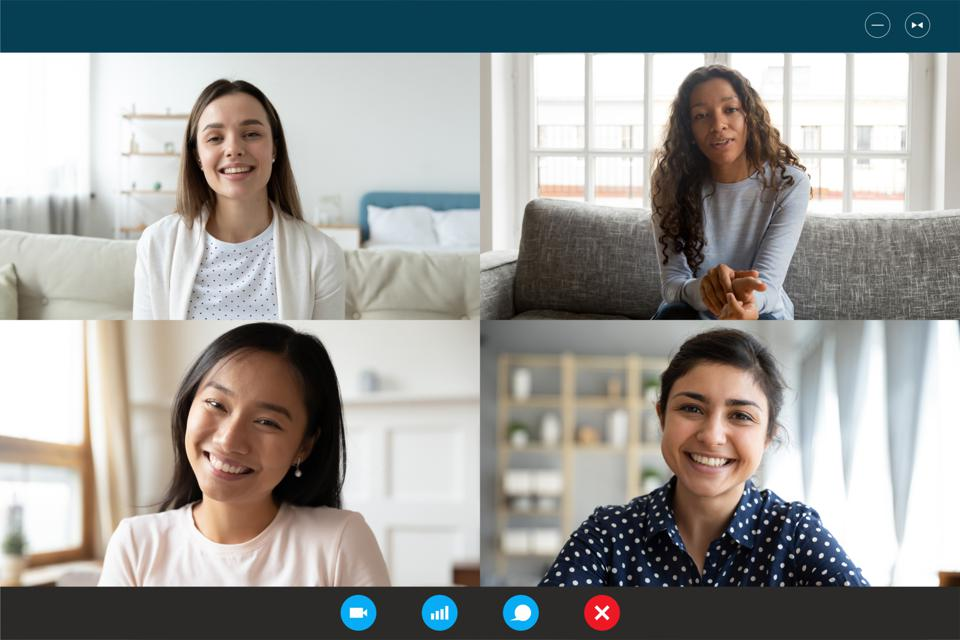 Laptop screen webcam view multiethnic women involved in group videocall
