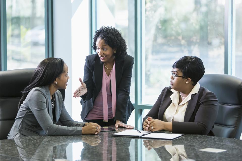 Three black women in business meeting