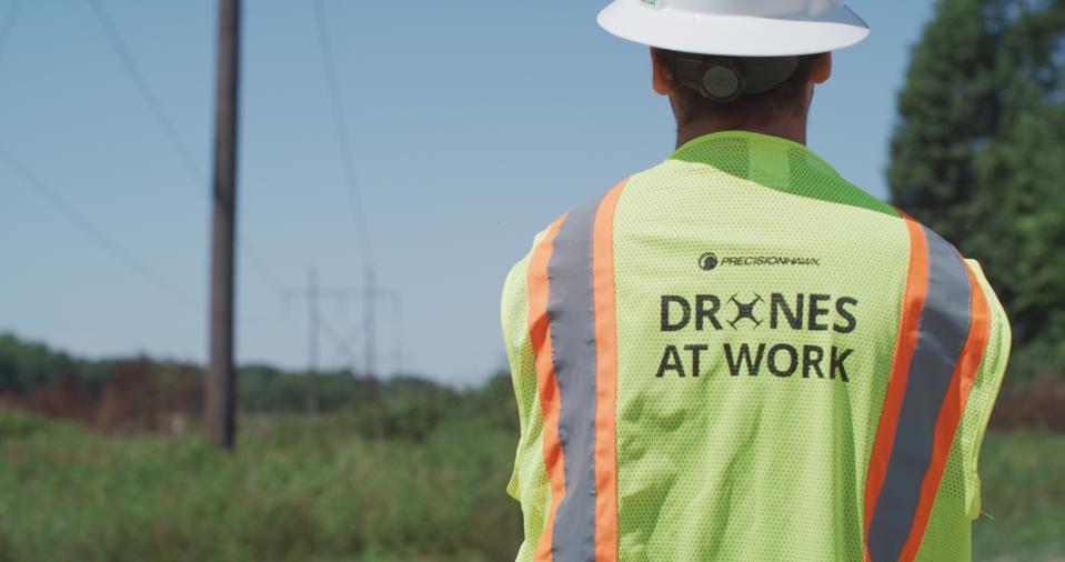 A PrecisionHawk supervisor overlooks drones operations.