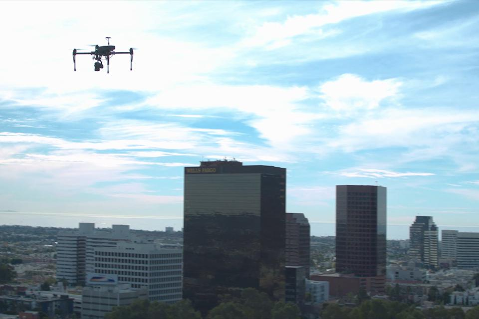 A PrecisionHawk drone over an urban landscape.