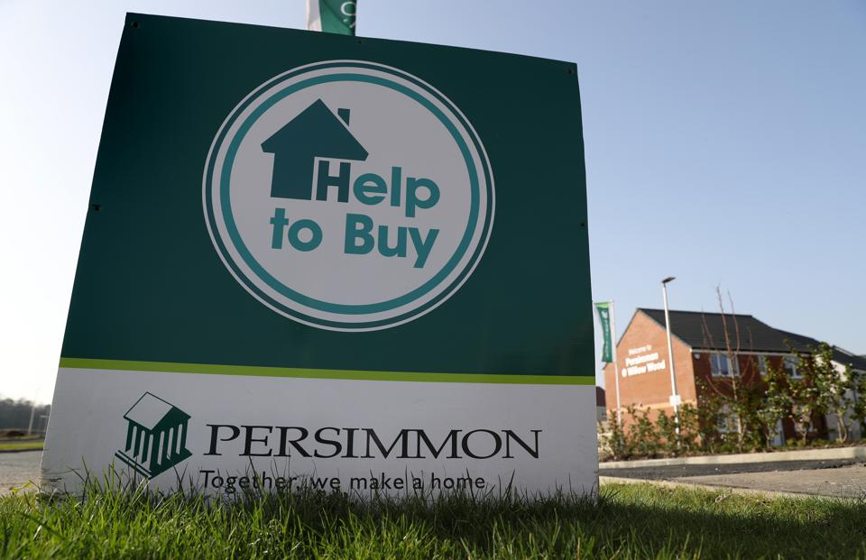 Persimmon signage in front of a new residential housing development.