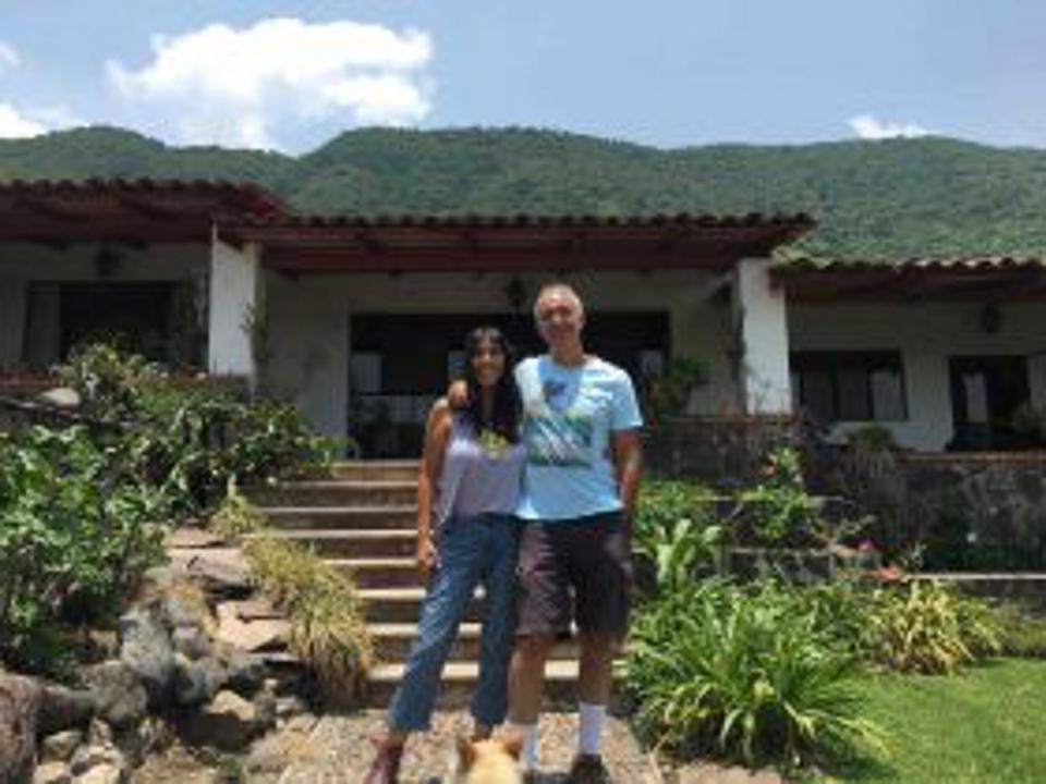 Jet Metier and Chuck Bolotin in front of home in Jocotepec, Mexico